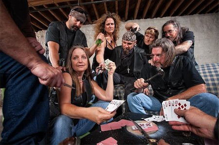 Mature female biker gang member shows cards to aggressive players Stock Photo - Budget Royalty-Free & Subscription, Code: 400-06396844