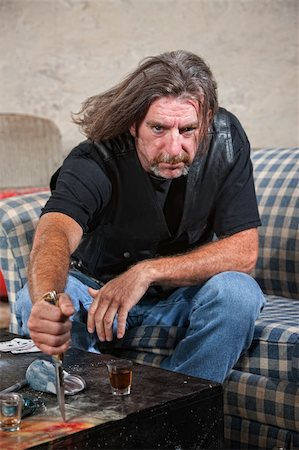 Angry Caucasian male gang member with knife and shot glass on table Stock Photo - Budget Royalty-Free & Subscription, Code: 400-06396847