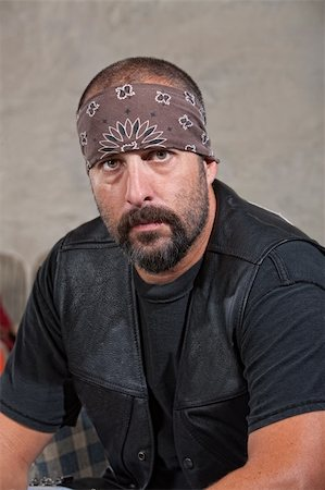 Serious bearded man with bandana and leather vest Stock Photo - Budget Royalty-Free & Subscription, Code: 400-06396854