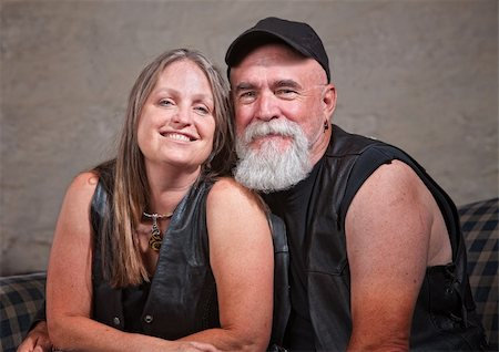 Adorable mature biker couple wearing leather vests Stock Photo - Budget Royalty-Free & Subscription, Code: 400-06396857