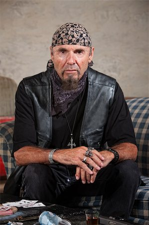 Frowning gang member in leather vest in cold stare Stock Photo - Budget Royalty-Free & Subscription, Code: 400-06396850
