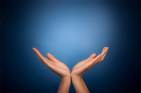 Hands holding on blue background Stock Photo - Budget Royalty-Free & Subscription, Code: 400-06391167