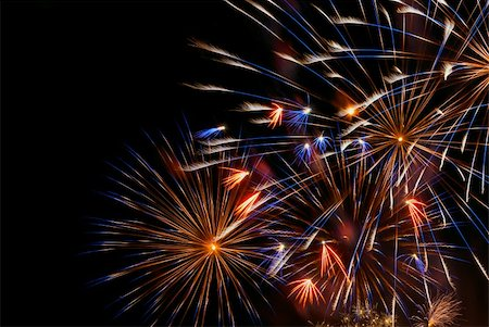 Beautiful colorful holiday fireworks on the black sky background, close-up, long exposure Stock Photo - Budget Royalty-Free & Subscription, Code: 400-06392254