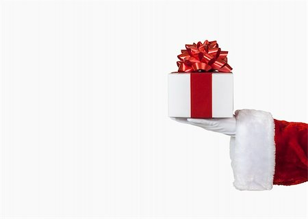 Santa holding a christmas present, includes clipping path Stock Photo - Budget Royalty-Free & Subscription, Code: 400-06416173