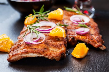 BBQ spare ribs marinated in orange sauce with herbs and wine Stock Photo - Budget Royalty-Free & Subscription, Code: 400-06416348