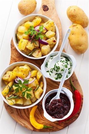 Baked potatoes with chutney and sour cream - top view Stock Photo - Budget Royalty-Free & Subscription, Code: 400-06416343