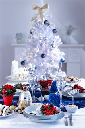 Place setting for Christmas in white and blue with the tree Stock Photo - Budget Royalty-Free & Subscription, Code: 400-06416371