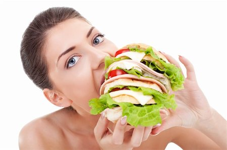 young woman eating a huge sandwich on white background Stock Photo - Budget Royalty-Free & Subscription, Code: 400-06419135