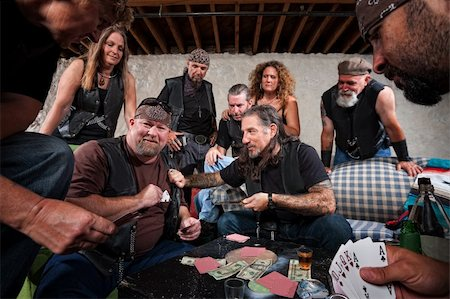 Rowdy biker gang gambling and pulling out weapons Stock Photo - Budget Royalty-Free & Subscription, Code: 400-06424144