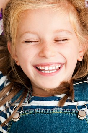 cute smiling girl with closed eyes Stock Photo - Budget Royalty-Free & Subscription, Code: 400-06424838