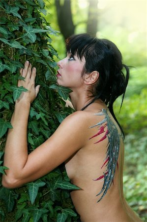 Young woman with painted wings on her back in the forest Stock Photo - Budget Royalty-Free & Subscription, Code: 400-06425419