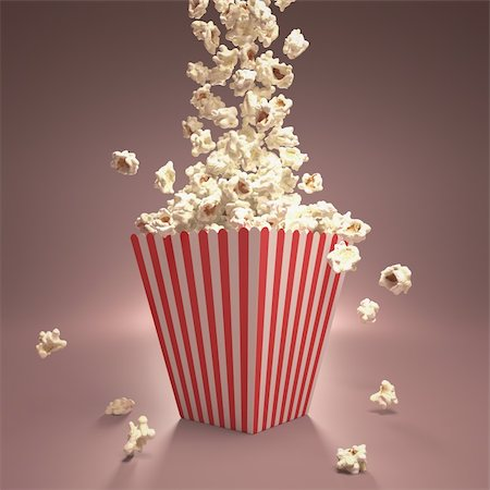 Dropping popcorn in striped classic package. Stock Photo - Budget Royalty-Free & Subscription, Code: 400-06421053