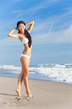 simsearch:400-04002563,k - A beautiful Chinese Asian young woman or girl wearing a white bikini on an empty deserted tropical beach with a blue sky Stock Photo - Budget Royalty-Free & Subscription, Code: 400-06421489