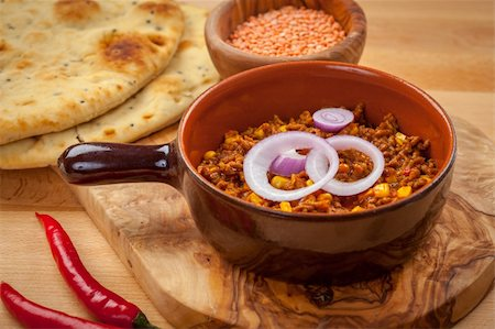 Mexican chilli con carne with red lentils and flatbread Stock Photo - Budget Royalty-Free & Subscription, Code: 400-06457295