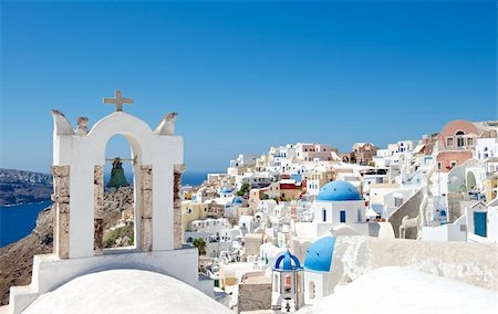 Architecture Greek cities very distinctive. Comfortable white houses and churches with bright color accents, very nice looking at the background of the blue sky. Stock Photo - Budget Royalty-Free & Subscription, Code: 400-06457632