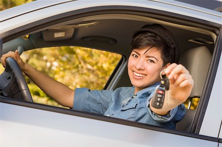 Happy Smiling Mixed Race Woman in Car Holding Set of Keys. Stock Photo - Budget Royalty-Free & Subscription, Code: 400-06457958