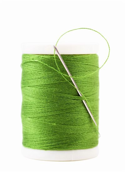 Single spool with green thread and needle Stock Photo - Royalty-Free, Artist: AGorohov, Image code: 400-06458313
