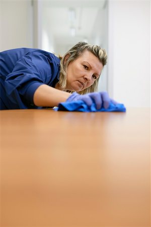diego_cervo (artist) - Woman at work, professional maid cleaning desk in office. Copy space Stock Photo - Budget Royalty-Free & Subscription, Code: 400-06464665