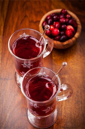 Hot drink with cranberries on white Stock Photo - Budget Royalty-Free & Subscription, Code: 400-06461722