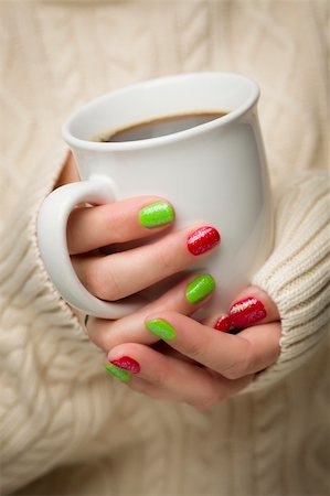 Woman in Sweater with Seasonal Red and Green Nail Polish Holding a Warm Cup of Coffee. Stock Photo - Budget Royalty-Free & Subscription, Code: 400-06462599