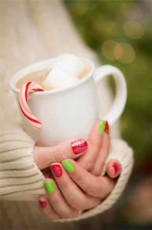 Woman in Sweater with Seasonal Red and Green Nail Polish Holding a Warm Cup of Hot Cocoa. Stock Photo - Budget Royalty-Free & Subscription, Code: 400-06462605