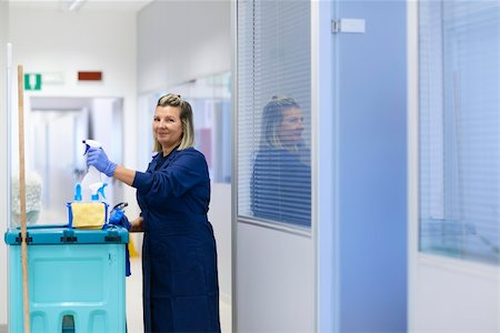 diego_cervo (artist) - Women at work, portrait of happy professional female cleaner smiling and looking at camera in office. Three quarter length Stock Photo - Budget Royalty-Free & Subscription, Code: 400-06463060
