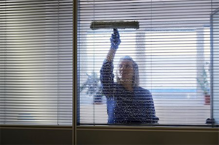 diego_cervo (artist) - Woman at work, professional female cleaner cleaning and wiping window in office with detergent Stock Photo - Budget Royalty-Free & Subscription, Code: 400-06463341