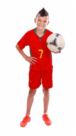 Young boy holding soccer ball, studio shot Stock Photo - Budget Royalty-Free & Subscription, Code: 400-06476932