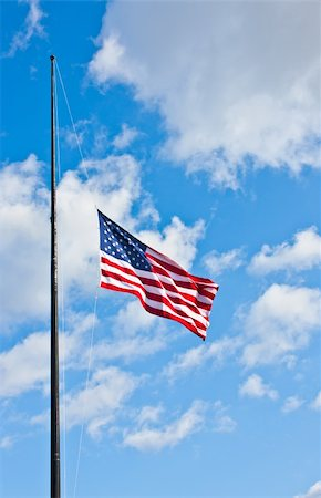 flag at half mast - American flag on a blue sky during a windy day Stock Photo - Budget Royalty-Free & Subscription, Code: 400-06478034