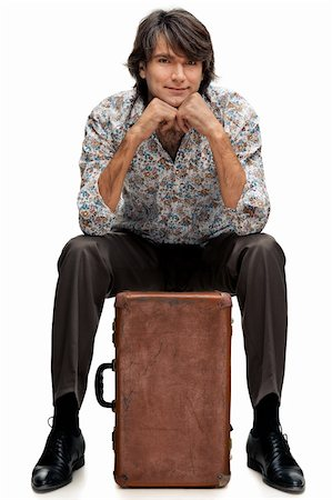 portrait of man with a suitcase on a white background Stock Photo - Budget Royalty-Free & Subscription, Code: 400-06471459