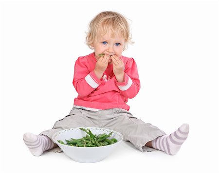 small girl eating grean peas on white background Stock Photo - Budget Royalty-Free & Subscription, Code: 400-06480358