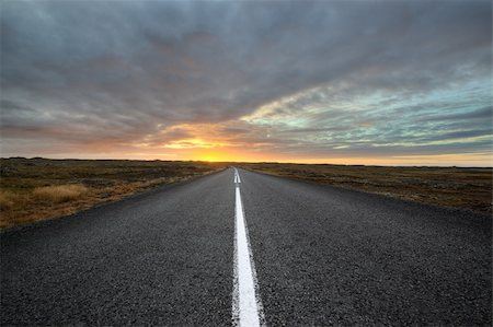 road landscape - deserted road one  Iceland at sunset Stock Photo - Budget Royalty-Free & Subscription, Code: 400-06519454