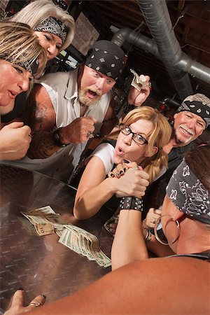 Excited motorcycle gang betting on arm wrestling match with nerd Stock Photo - Budget Royalty-Free & Subscription, Code: 400-06525847