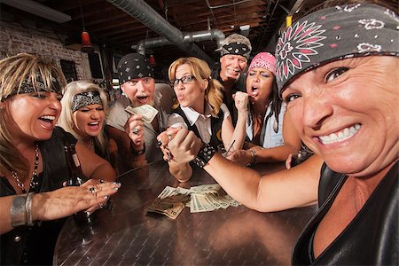 Tough female losing an arm wrestling contest with nerd Stock Photo - Budget Royalty-Free & Subscription, Code: 400-06525849