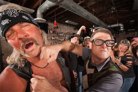Confident geek punches mature biker gang man on chin Stock Photo - Budget Royalty-Free & Subscription, Code: 400-06525854