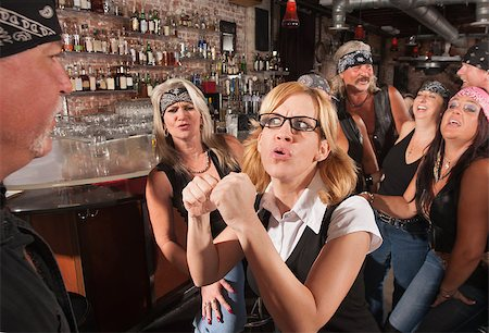 Female geek puts up fist to tough man in bar Stock Photo - Budget Royalty-Free & Subscription, Code: 400-06525855