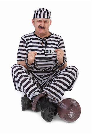 prisoner is struggling with handcuffs over white background Stock Photo - Budget Royalty-Free & Subscription, Code: 400-06521889