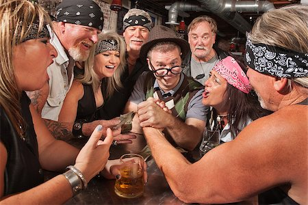 Confident nerd wins arm wrestling match in biker bar Stock Photo - Budget Royalty-Free & Subscription, Code: 400-06522836