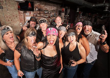 Loud motorcycle gang members with weapons and drinks Stock Photo - Budget Royalty-Free & Subscription, Code: 400-06522837