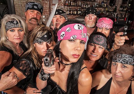 Threatening motorcycle gang members with gun and knife Stock Photo - Budget Royalty-Free & Subscription, Code: 400-06522838