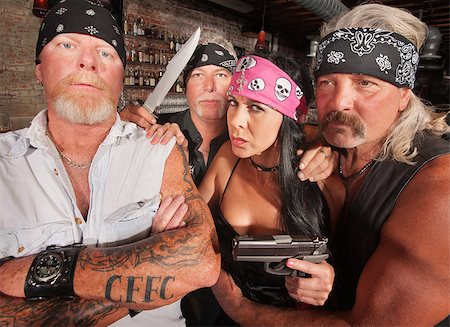 Four tough motorcycle gang members with weapons in tavern Stock Photo - Budget Royalty-Free & Subscription, Code: 400-06522839