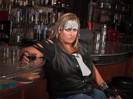 Angry mature woman with alcohol leaning back in a tavern Stock Photo - Budget Royalty-Free & Subscription, Code: 400-06530597