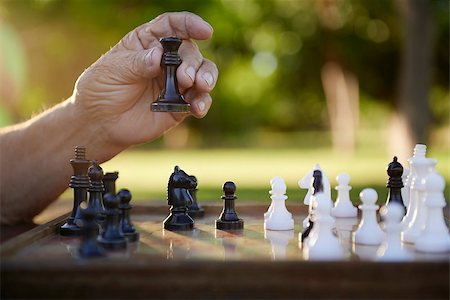 diego_cervo (artist) - Active retired persons, hand of old man holding chess piece in park. Closeup shot, copy space Stock Photo - Budget Royalty-Free & Subscription, Code: 400-06530998