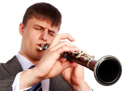 Young musician plays the clarinet on a white background Stock Photo - Budget Royalty-Free & Subscription, Code: 400-06557583