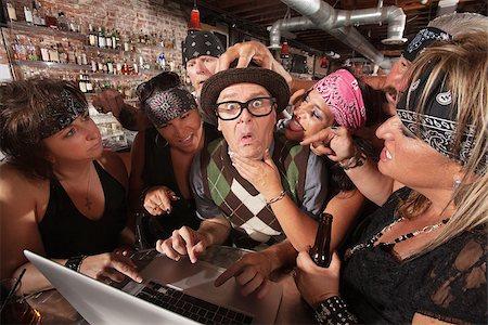 Pretty biker gang women adoring nervous male nerd in bar Stock Photo - Budget Royalty-Free & Subscription, Code: 400-06557765
