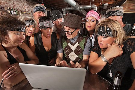 Group of impressed biker gang members watching nerd using a computer Stock Photo - Budget Royalty-Free & Subscription, Code: 400-06557766