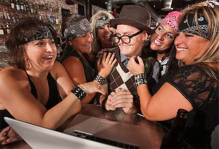 Motorcycle gang members flirting with happy nerd on laptop Stock Photo - Budget Royalty-Free & Subscription, Code: 400-06557767