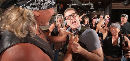 Angry nerd threatens bully gang member in bar Stock Photo - Budget Royalty-Free & Subscription, Code: 400-06557768