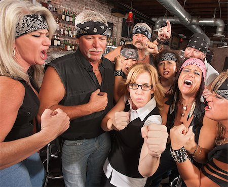 Motorcycle gang and female nerd holding up fists in bar Stock Photo - Budget Royalty-Free & Subscription, Code: 400-06557775