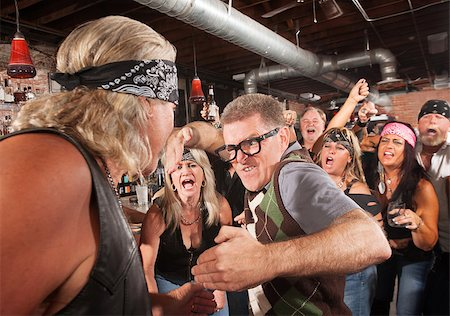 Nerd readies a karate chop in fight with gang member Stock Photo - Budget Royalty-Free & Subscription, Code: 400-06557770